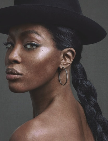 Naomi Campbell wearing a hat and hoop earrings