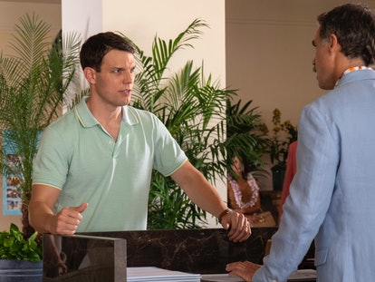 Jake Lacy plays Shane Patton on 'The White Lotus.' He is wearing a green polo shirt and staring angr...