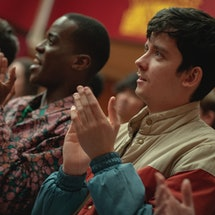 Adam, Eric, and Otis clap during assembly