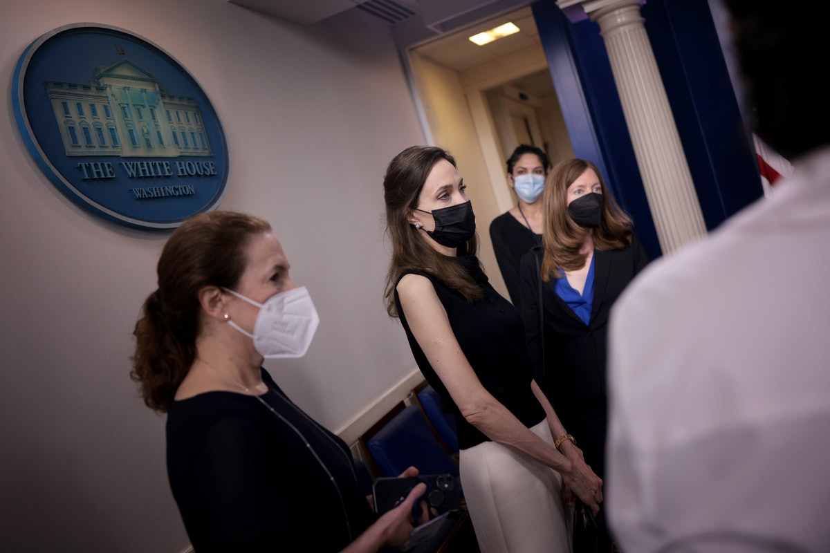 Actress and activist Angelina Jolie (2nd L) talks with reporters in the White House briefing room b...