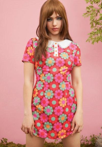 Woman wearing mod floral dress