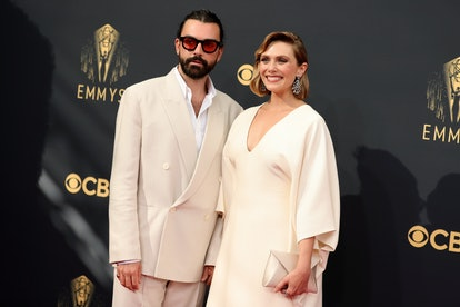 Robbie Arnett and Elizabeth Olsen at the 2021 Emmys