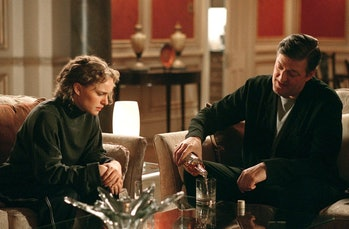 Evey (Natalie Portman) and Dietrich (Stephen Fry) share a drink in V for Vendetta.