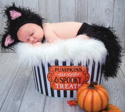 Baby dressed in a cat costume
