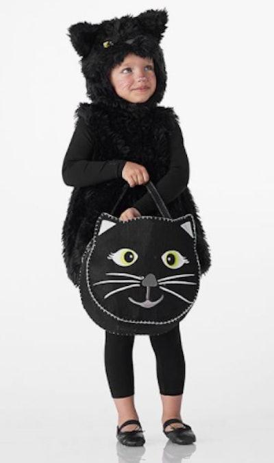 Girl wearing black cat costume