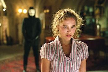 Evey (Natalie Portman) stares in disbelief at V's home in V for Vendetta.
