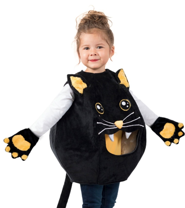 Girl dressed in a Halloween cat costume