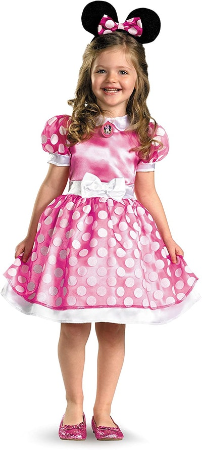 Toddler in pink Minnie Mouse dress and ears
