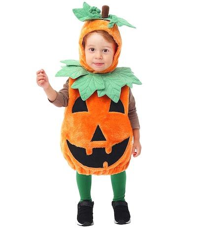 Toddler in a pumpkin costume