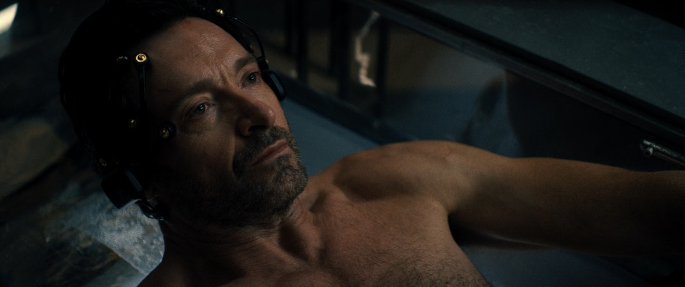 Hugh Jackman is submerged in a sensory deprivation tank in Reminiscence.