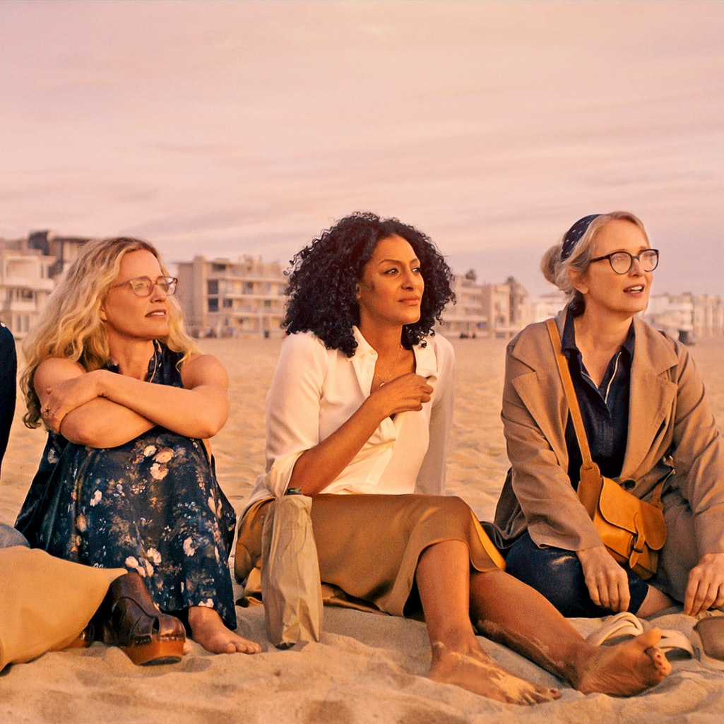 Four women sit on the beach and talk in the TV show 'On The Verge.'