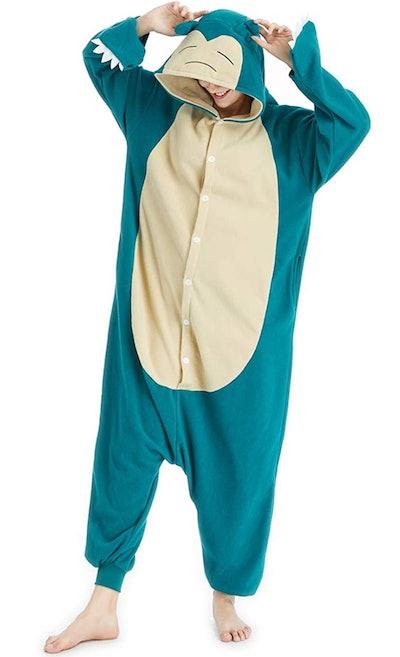 Adult posing in Snorlax onesie costume
