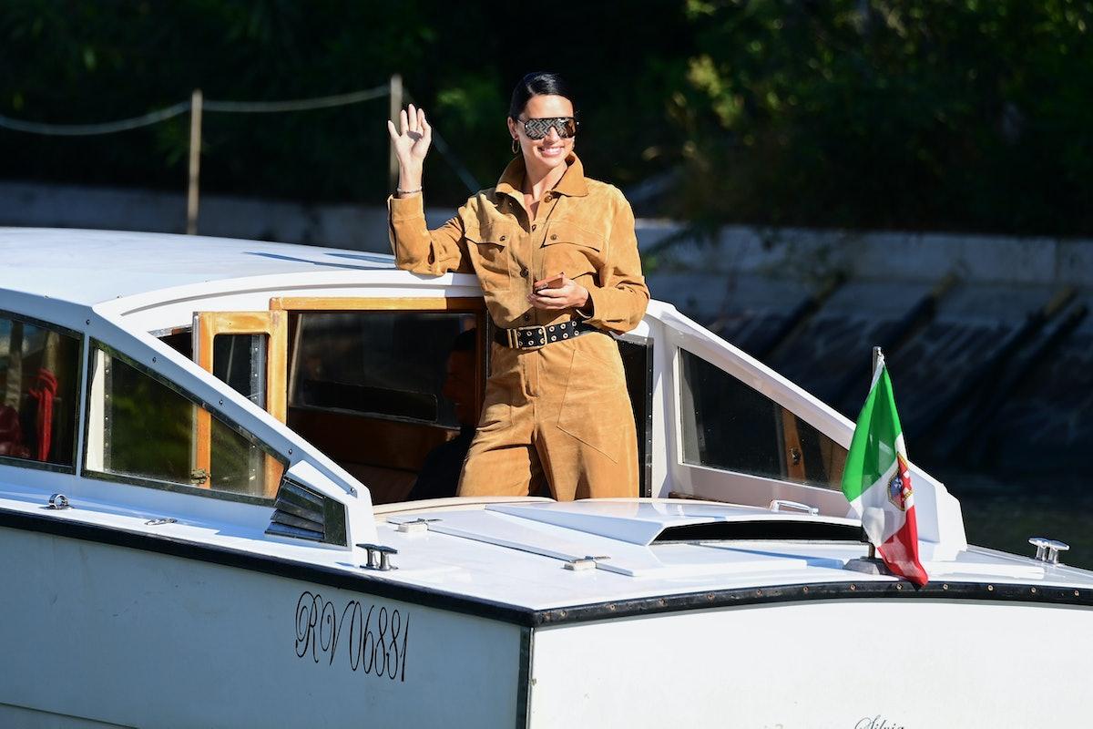 Adriana Lima smiling and waving