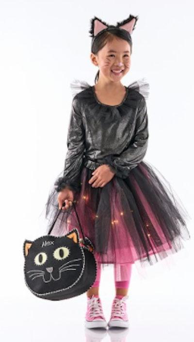 Girl wearing light up cat tutu costume