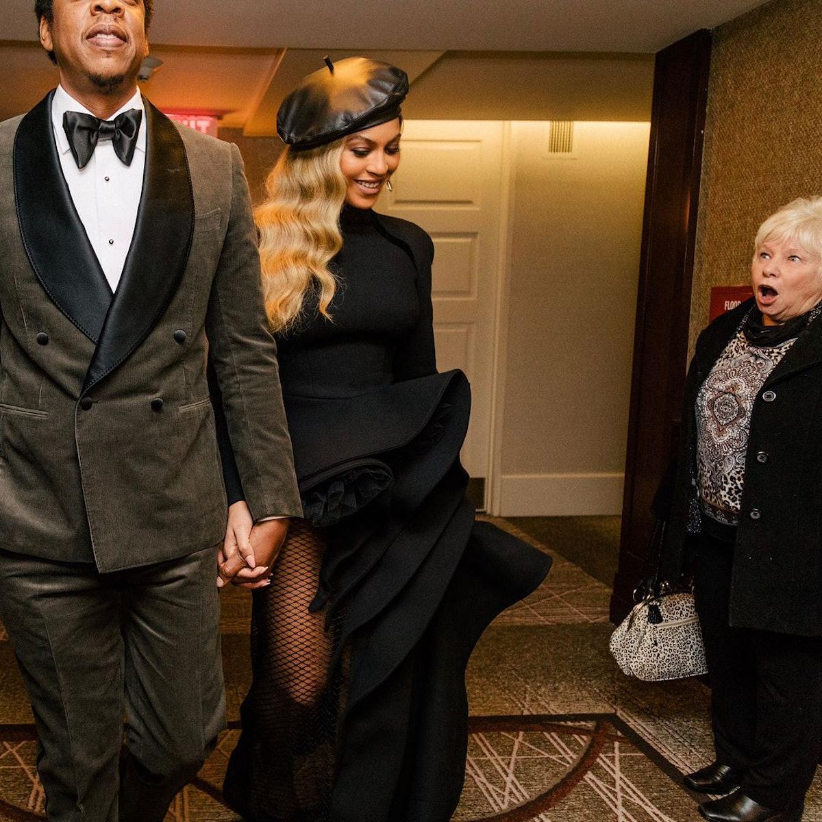A woman gaping at Beyoncé and Jay-Z