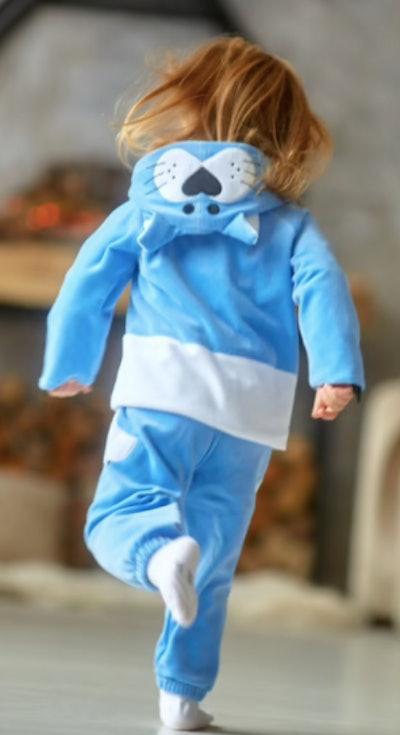 Child wearing a blue cat costume