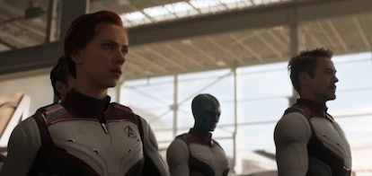 """A still from the movie 'Avengers: Endgame,"""" with Black Widow, Nebula, and Iron Man walking."""
