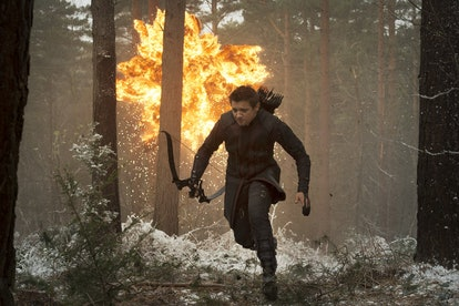 A still from 'Avengers: Age of Ultron,' with Hawkeye running from an explosion in the woods.
