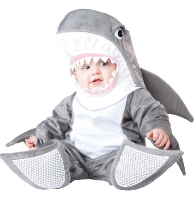 Baby wearing a shark costume