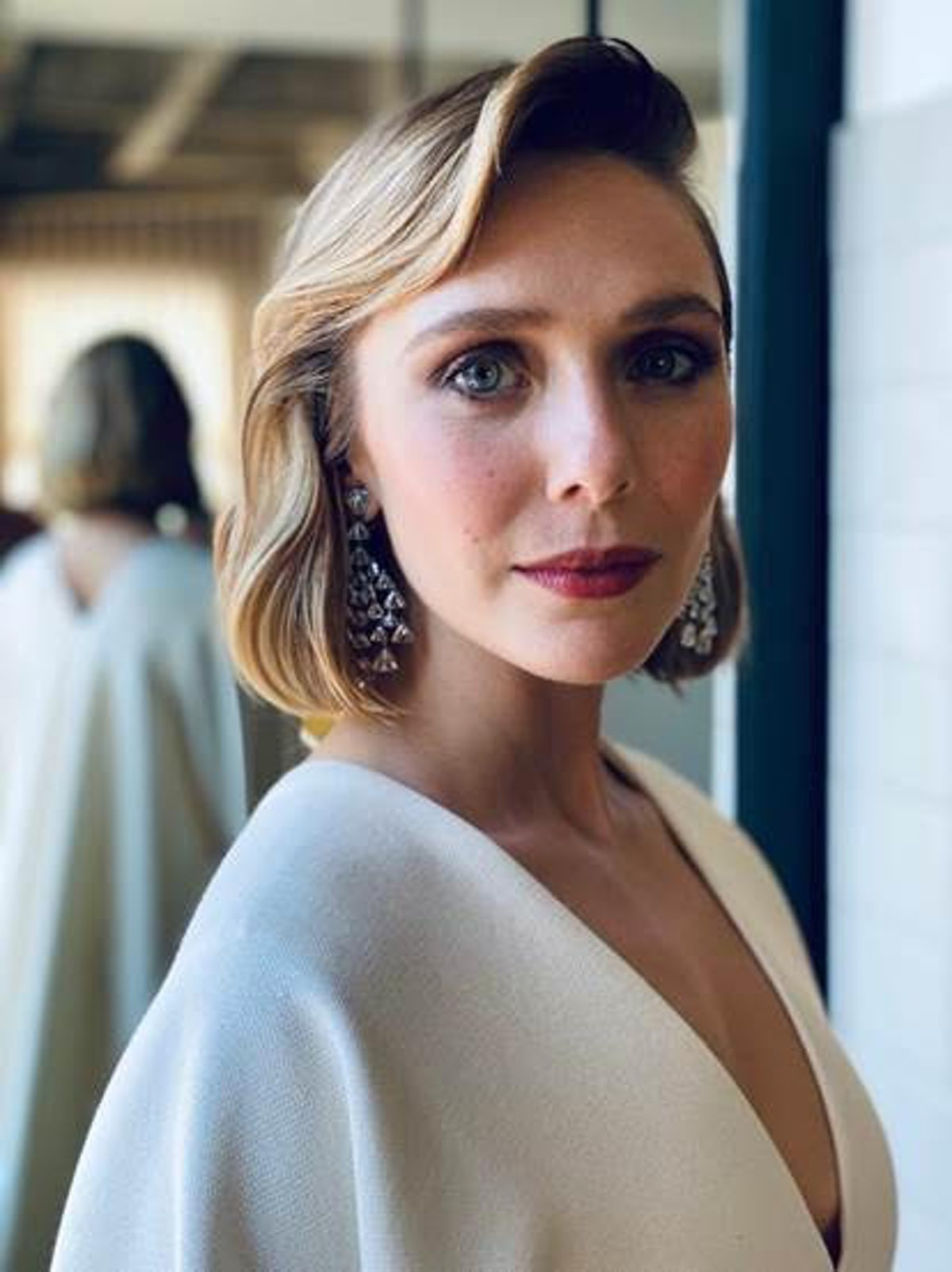 Elizabeth Olsen poses with her hair done ahead of the 2021 Emmy Awards