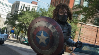 A still from 'Captain America: The Winter Soldier' with the masked, long-haired Winter Soldier holdi...