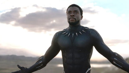 A still from 'Black Panther,' with Chadwick Boseman as Black Panther with arms outstretched, ready f...