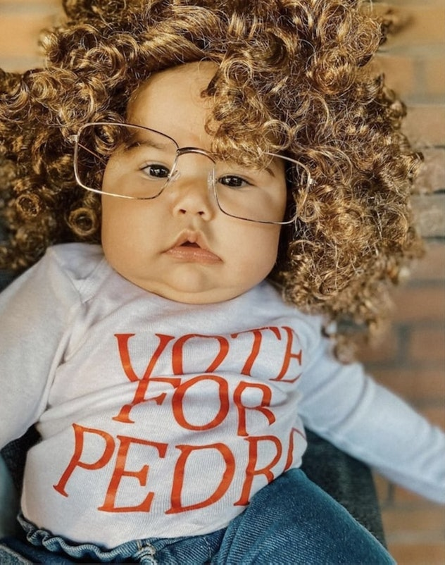 """baby dressed as Napoleon Dynamite for Halloween- curly wig, glasses, and """"Vote For Pedro"""" Tshirt"""