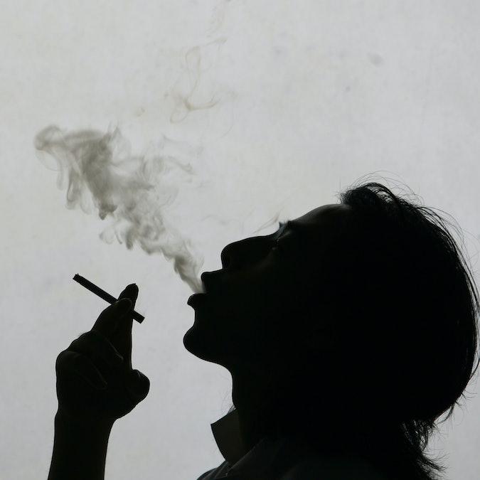 person smokes