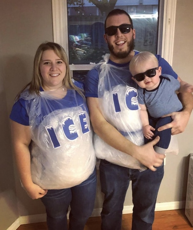 parents dresses as bags of ice, holding baby in sunglasses, they are the punny costume Ice Ice Baby