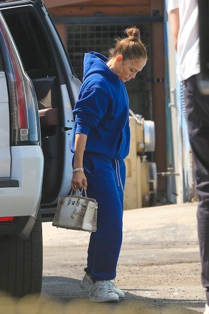Jennifer Lopez in a Les Tien blue sweatsuit.