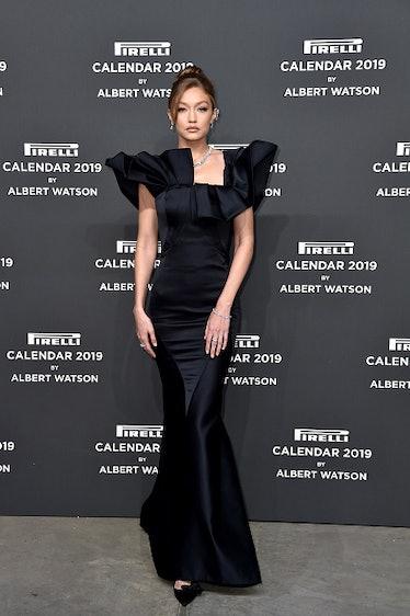Gigi Hadid walks the red carpet ahead of the 2019 Pirelli Calendar launch gala at HangarBicocca on D...