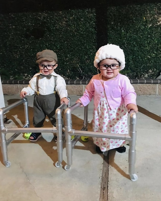 two babies dressed as elderly people with walkers for Halloween