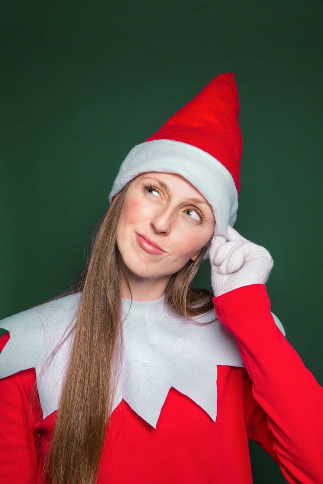 Woman dressed up as Elf on the Shelf