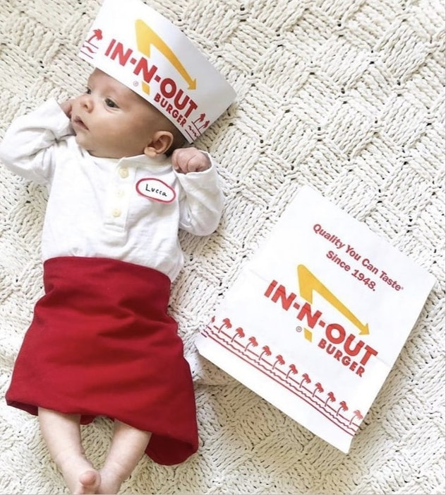 baby dressed for Halloween as an In-N-Out employee, in apron and hat