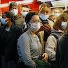 Passengers on train wear Covid-19 masks