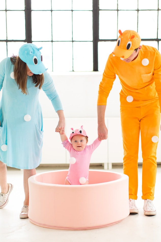Mom, Dad, and baby dressed in Hungry, Hungry Hippos costumes