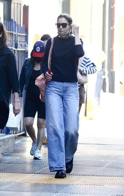 Katie Holmes wearing jeans, a sweater, Vagabond platform loafers while walking in New York City.