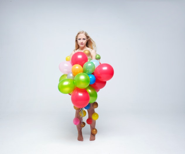 Woman dressed as a bundle of colorful balloons