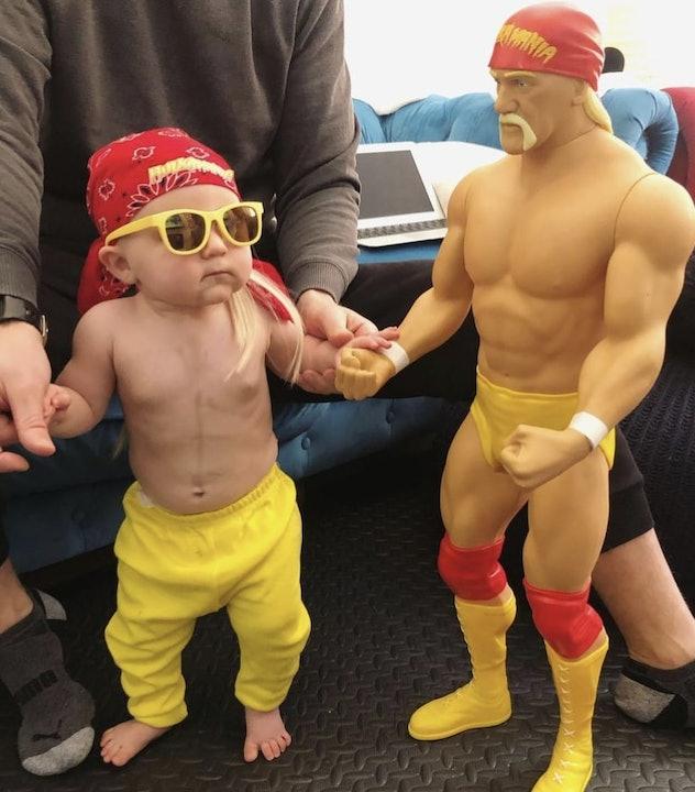 baby dresses as wrestler Hulk Hogan in yellow pants, yellow sunglasses, red bandana, standing next t...