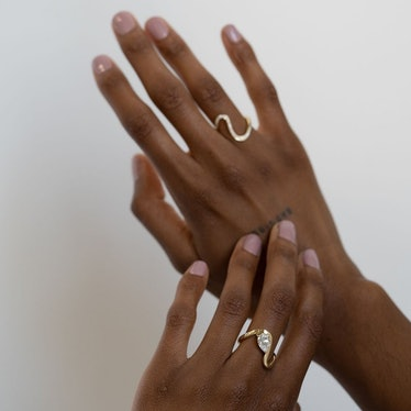 Model wears two rings from KatKim's Trace Ring collection on Instagram, August 25, 2021.