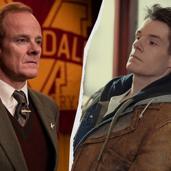 Alistair Petrie as Mr Groff wearing a suit against a backdrop of the Moordale High Logo (a large yel...