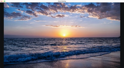 Download this beach Zoom background of a sunset over the waves.