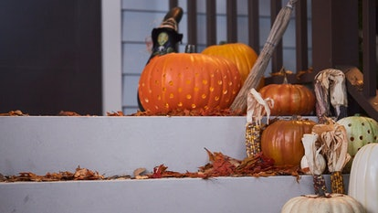 These Halloween Zoom backgrounds include a festive porch scene with pumpkins.