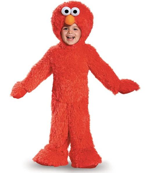 Child wearing an Elmo costume