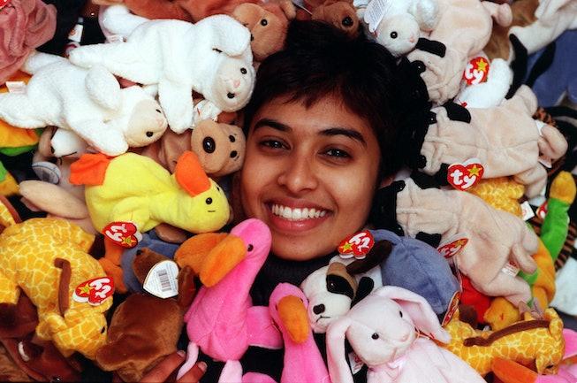 Nawshika Ganegama in a pile of Beanie Babies.