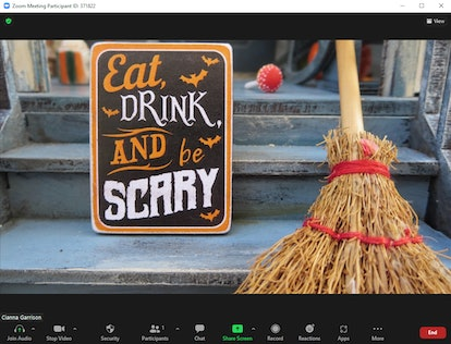 """These Halloween Zoom backgrounds include an """"Eat, drink, and be scary"""" sign."""