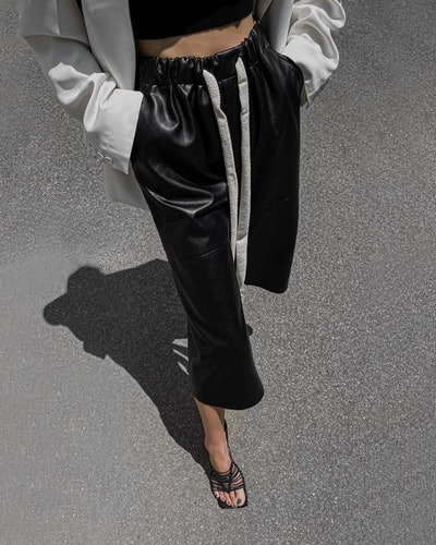 Black leather track pants.