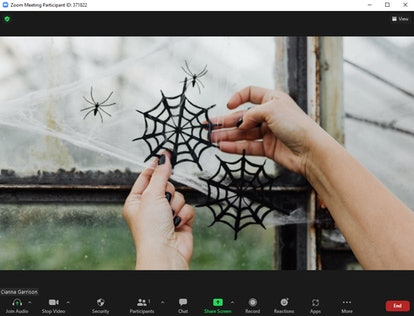 These Halloween Zoom backgrounds feature creepy cobwebs.