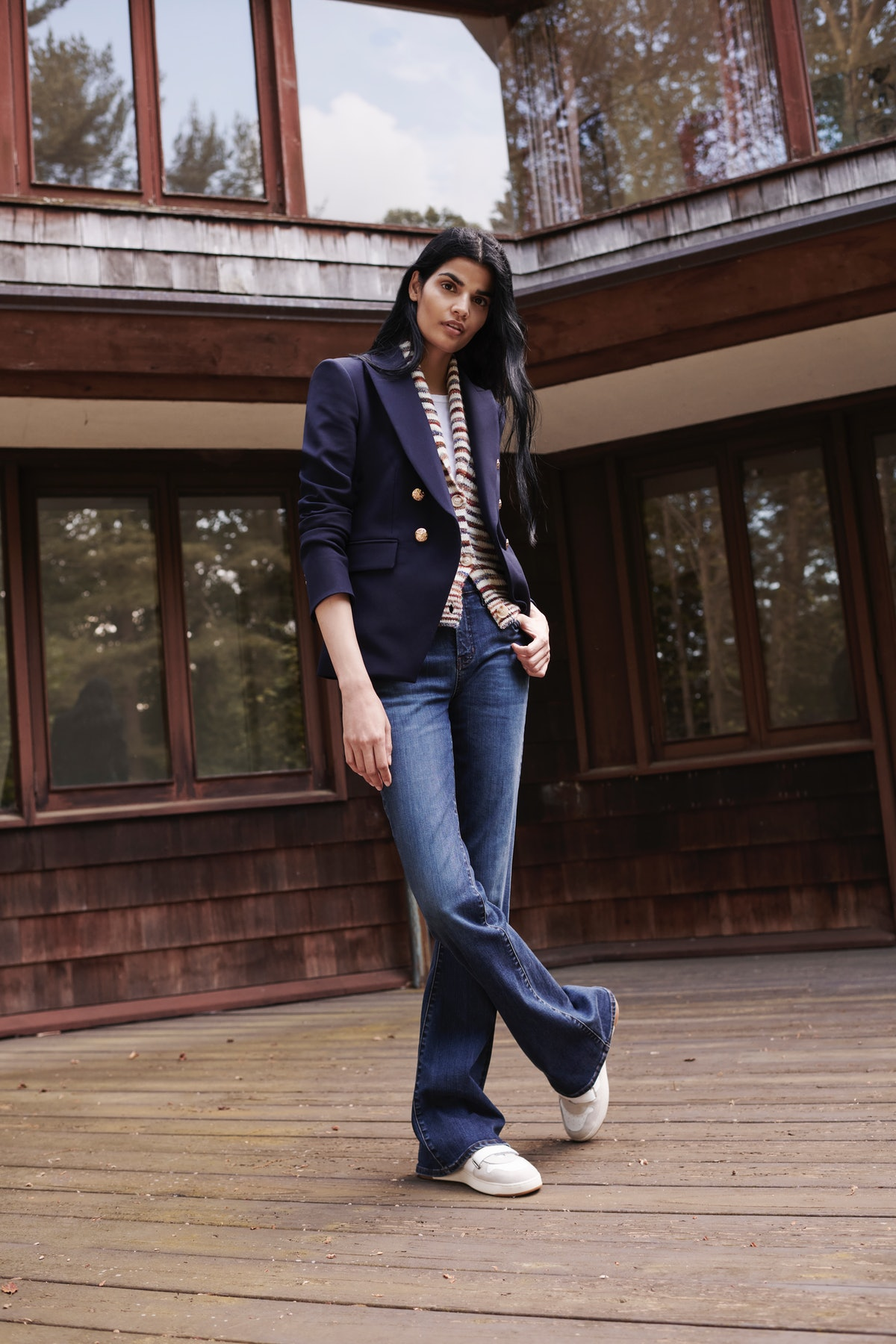Model wearing blazer and cardigan by Veronica Beard.