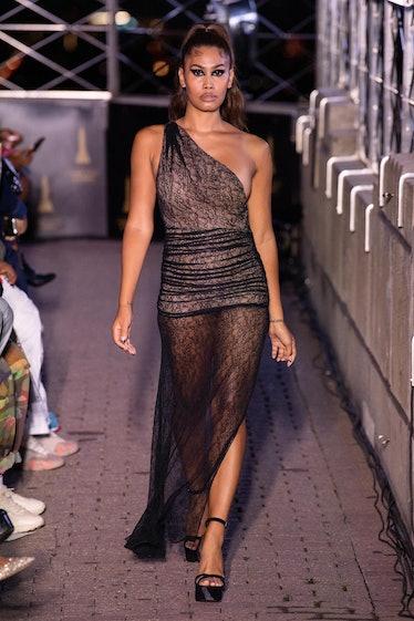 Leyna Bloom walking LaQuan Smith